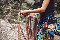 Woman holding climbing rope near the rock Royalty Free Stock Image