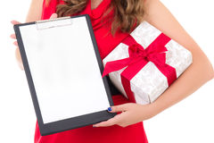 Woman holding clipboard with copyspace and gift box isolated on Royalty Free Stock Photo