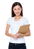 Woman holding with clipboard Royalty Free Stock Photography