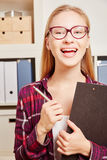 Woman holding a clipboard and a pen Stock Image