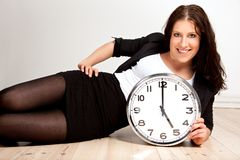 A Woman Holding a Clock Royalty Free Stock Image