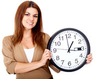 Woman holding a clock Stock Photos