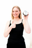 Woman holding a clock Stock Photography