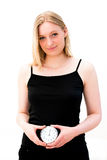 Woman holding a clock Royalty Free Stock Photo