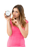 Woman holding a clock Stock Image