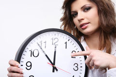 Woman holding clock. Stock Photos