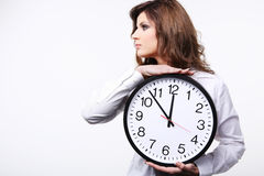 Woman holding clock. Royalty Free Stock Photos