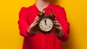Woman holding clock Stock Photo