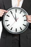 Woman holding a clock Royalty Free Stock Photography