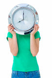 Woman holding clock in front of her face Royalty Free Stock Photos