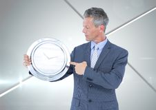 Woman holding clock in front of shiny chrome silver grey background Stock Images