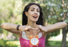 Woman holding clock in hands Royalty Free Stock Images