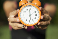 Woman holding clock in hands Royalty Free Stock Photo