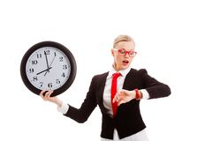 Woman holding clock and looking to watch Stock Photography