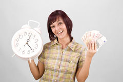 Woman holding clock and money Royalty Free Stock Image