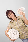 Woman holding clock and money Stock Image