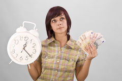 Woman holding clock and money Royalty Free Stock Photo