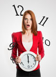Woman holding a clock with numbers flying Stock Photos