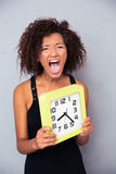 Woman holding clock and shouting Royalty Free Stock Photo
