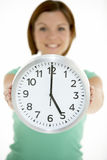 Woman Holding Clock Showing 5 O'Clock Royalty Free Stock Image