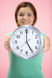 Woman Holding Clock Showing 5 O'Clock Royalty Free Stock Images