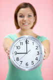 Woman Holding Clock Showing 9 O'Clock Stock Images