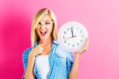 Woman holding clock showing nearly 12 Royalty Free Stock Photo