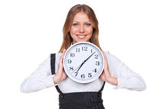Woman holding the clock and smiling Royalty Free Stock Photo