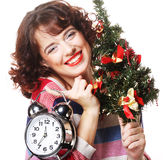 Woman holding clock and the tree Royalty Free Stock Image