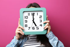 Woman holding a clock Stock Photo