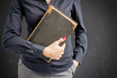 Woman holding closed book royalty free stock photos