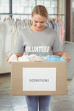 Woman holding clothes donation box Stock Photography