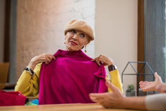 Woman holding clothes. Royalty Free Stock Photos
