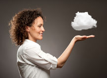 Woman holding a cloud Royalty Free Stock Images
