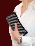 Woman Holding Clutch Bag Stock Photo