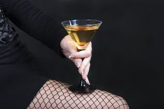 The woman holding a cocktail Stock Images