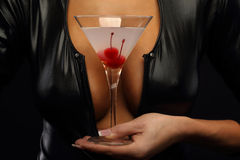 Woman holding cocktail with cherry Royalty Free Stock Photo