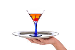 Woman holding Cocktail on Tray Royalty Free Stock Photo