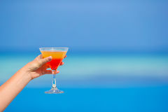 Woman holding cocktail on tropical beach Stock Photos