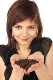 Woman holding coffee beans Stock Images