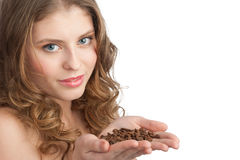 Woman holding coffee beans Stock Photos