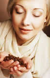 Woman holding coffee beans. Stock Photo