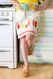 Woman holding coffee cup in retro kitchen Stock Photos