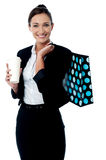 Woman holding coffee cup and shopping bag Royalty Free Stock Image