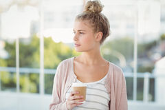 Woman holding coffee cup Stock Photography