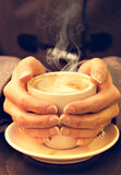 Woman holding coffee latte. Royalty Free Stock Image