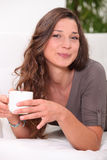 Woman holding coffee mug Stock Image