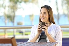 Woman holding a coffee mug in an apartment balcony Stock Image