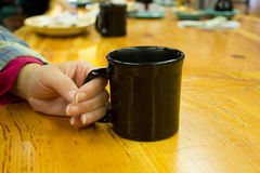 Woman holding a coffee mug Stock Photography