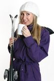 Woman holding coffee and skis Royalty Free Stock Photo